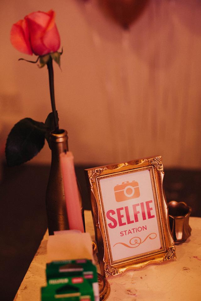 Selfie Station table setup gold and pink